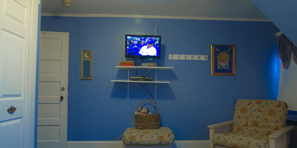New Flat Screen TV and Sitting area. Private bathroom in the room. Free Wi-Fi